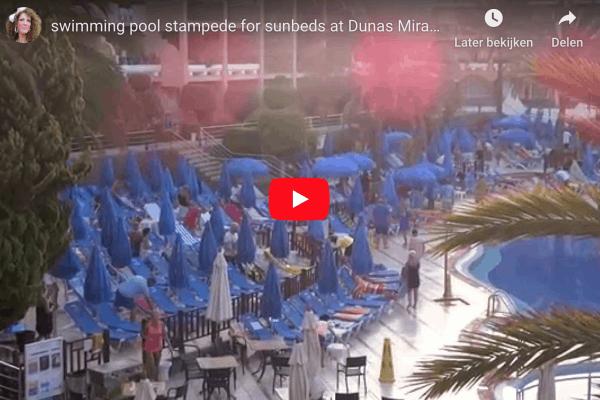 Handdoekenrace bij het zwembad